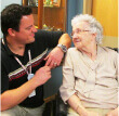 Fairmount Home employee talking to a resident